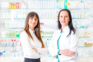 two smiling pharmacist at the drugstore